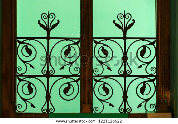 Victorian Ornamental Wrought Iron Window Grill Stock Photo