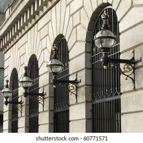 Victorian Street lamps on the building front, Sugar Quay, London, UK