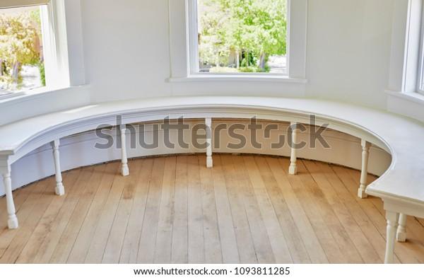 Victorian style half Round Wooden Window Bench and old oak flooring being restored.