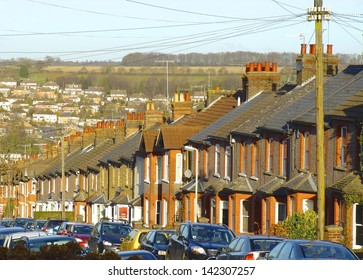 Victorian terrace in suburban England going down a steep valley.