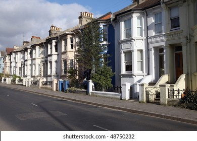 victorian terraces in england. street with english houses or homes