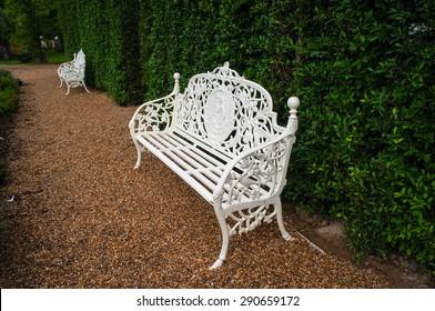 Victorian white chairs in the garden
