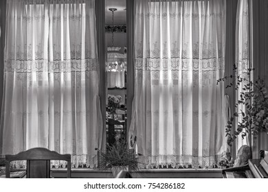 Victorian window with curtain