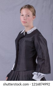 Victorian woman in black ensemble