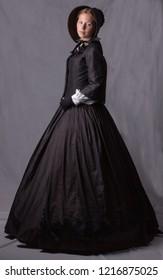 Victorian woman in black ensemble