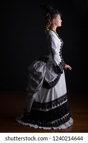 Victorian woman in black and white dress