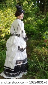 Victorian woman in bustle dress