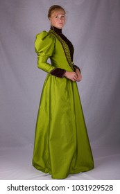 Victorian woman full length plain background green dress right side