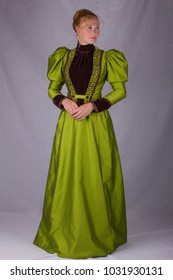 Victorian woman full length plain background green dress front view