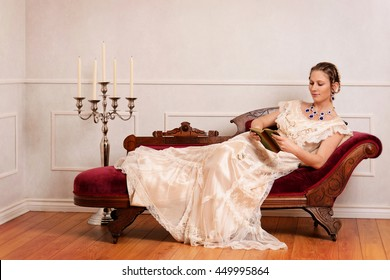 Victorian Woman Reading Book On Fainting Stock Photo (Edit Now ... on victorian rocking chair, victorian folding chair, victorian credenza, victorian urns, victorian club chair, victorian tables, victorian wheelchair, victorian country, victorian chaise furniture, victorian loveseat, victorian mother's day, victorian chaise lounge, victorian chest, victorian sideboard, victorian recliner, victorian candles, victorian era chaise, victorian nursing chair, victorian office chair, victorian couch,