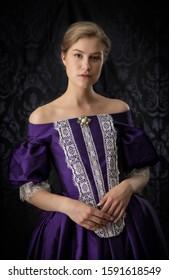 Victorian woman in a silk evening dress