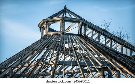 Victorian wooden framed greenhouse ruin.