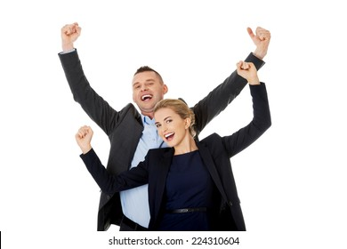 Victorious business couple with hands up.