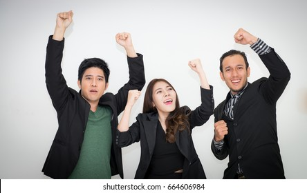 Victorious corporate man celebrating with his arms lifted in the air,Happy business people with arms up celebrating - isolated over white,Business team celebrating a triumph with arms up,