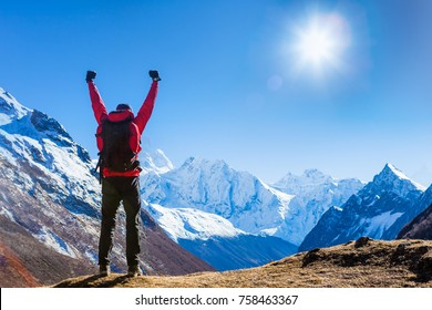 Victorious man Enjoying the Success in Himalayas Mountains, Nepal