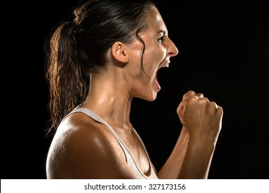 Victorious scream shout celebration intense woman athlete victory winning female champion