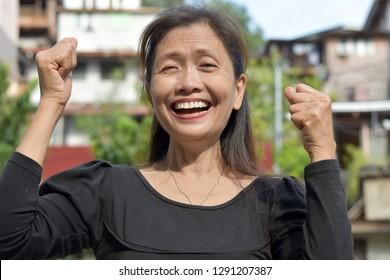 A Victorious Senior Woman