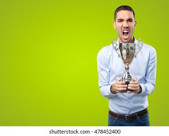 Victorious young man on green background