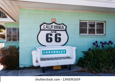 Victorville, CA / USA – March 9, 2017: A Chevrolet truck tailgate serves as a bench for Route 66 tourist at Emma Jean's Holland Burger Cafe, in Victorville, California.