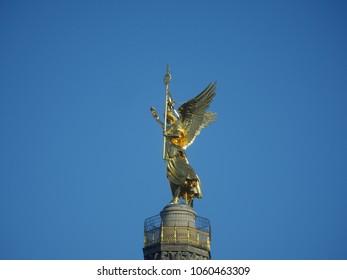 Victory Column in Berlin on blue sky background