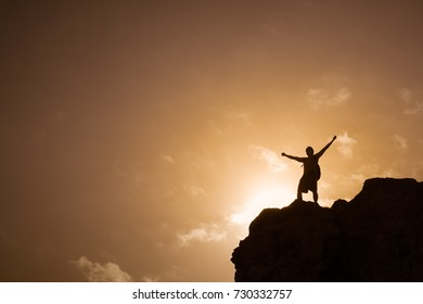 Victory on top of a mountain. Challenge yourself, adventure, and winning.