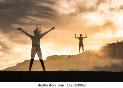 Victory and strength concept. Strong victorious woman standing hight on a mounting flexing arms and feeling free.