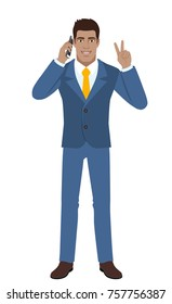 Victory! Two fingers up. Businessman talking on the mobile phone and showing victory sign. Full length portrait of Black Business Man in a flat style. Raster illustration.