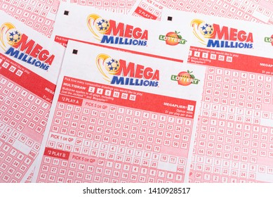 Vidalia, Georgia / USA - May 27, 2019: A close-up and detailed look at a spread of the official numbers game printed sheets for Georgia's Mega Millions lottery set on a plain white paper background.