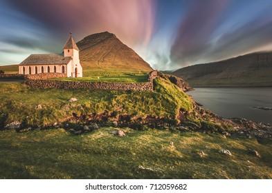 Vidareidi village, Vidoy island, Faroe Islands, Denmark. Village's church at sunset