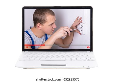 video blog and tutorial concept - young man showing how to install or repair power socket
