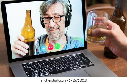 Video call between friends, distant relatives, middle-aged man toasts with beer together with another person using modern communication technologies