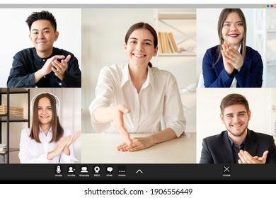 Videoanruf. Online-Sitzung. Gruppenkonferenz für Telekommunikation. Remote-Arbeit. Screenshot des fröhlichen, multiethnischen Unternehmensteams, das Grußweibchen begrüßt und Handshake in virtuellen Büros anbietet.