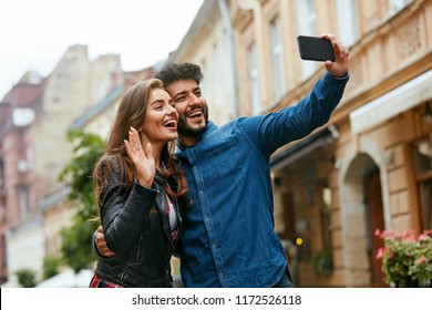 Video Call. People Using Phone For Internet Call In City.