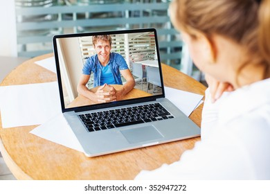 video call. woman and man talking on web camera in office