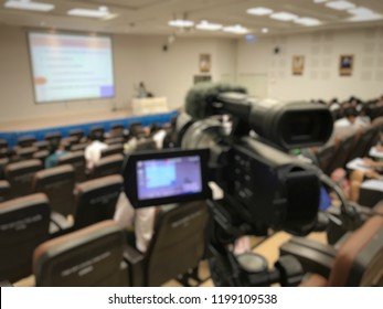 Video camcorder or video camera recording lecturer live in seminar hall or ted talk business people community. Education or seminar concept blur image use for background.