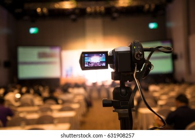 video camera in business conference room recording participants and speaker
