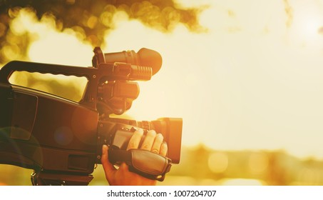 Video camera / videographer close up / cameraman / movie