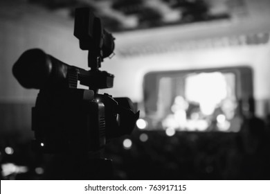 Video camera at the concert. Capture a video. Black and white art monochrome photography.