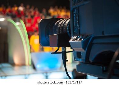 Video camera lens - recording show in TV studio - focus on camera aperture