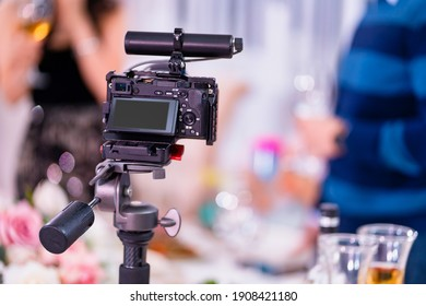 video camera on a tripod. installation of equipment for shooting events and holidays. professional shooting. Russia, Rostov-on-Don, 21.01.2021
