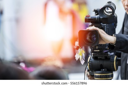 Video camera operator working with his equipment - Shutterstock ID 556157896