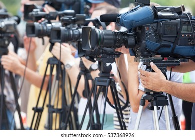 Video camera operators working at news conference