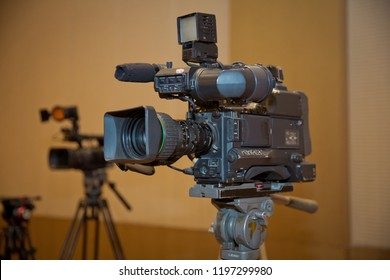 video camera set on a tripod (with excellent clipping path) . Professional production video camera.