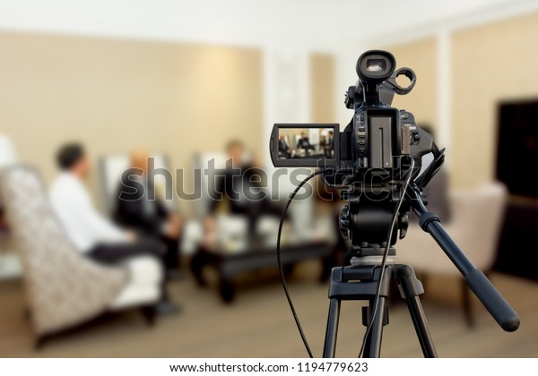 Video camera taking live video streaming at people talking background