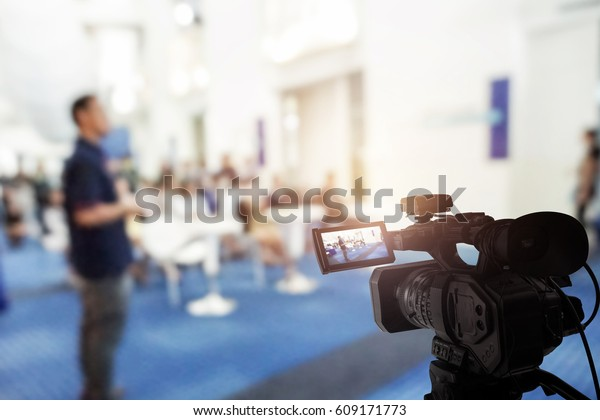 Video camera taking live video streaming at event background