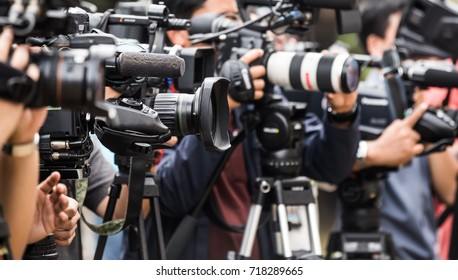Video cameras operator working with professional equipment, selective focus