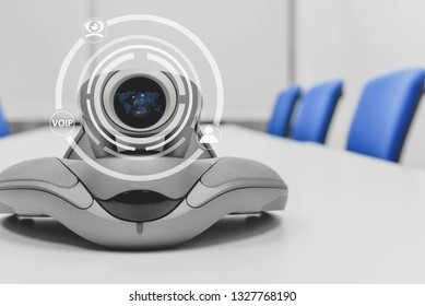 Video conference device with technology icon of cam, human and voip for connection technology concept
