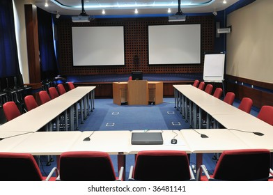 video conference room with chairs and big board  projector canvas and computer
