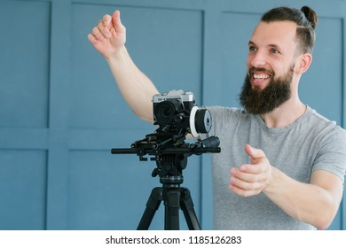 video content creation process. cameraman shooting footage for vlog broadcast or report and giving instructions. professional at work concept.
