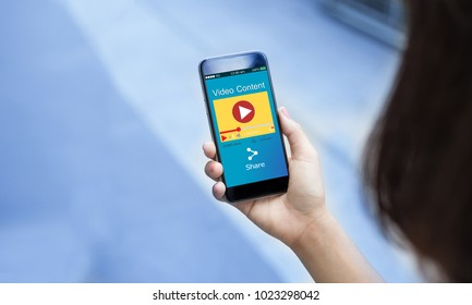 Video content marketing concept.Female hands holding mobile phone